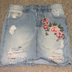 Dresses & Skirts - adorable ripped jean skirt with flower embroidered